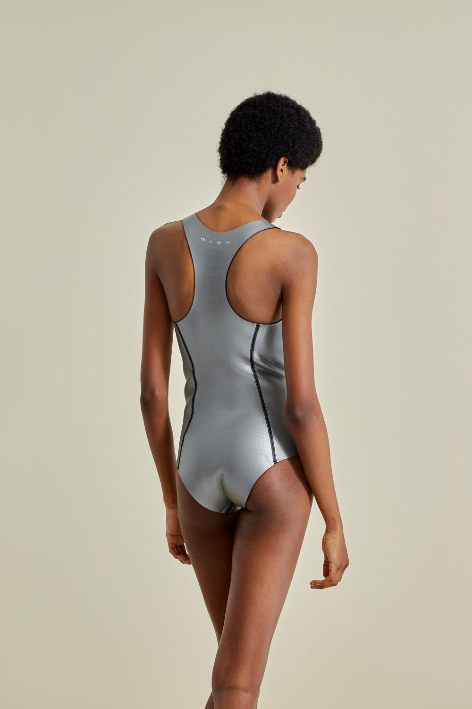 Neoprene wetsuit, petroleum-free surf ecoprene. Sylvia in silver, by NOW_THEN, sustainable swimwear.